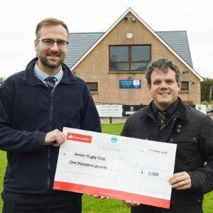"""FUNDS BOOST . . . Last week Callum Adam, left, Development Manager of Cunninghame Housing Association presented a cheque for £1000 to the Annan Rugby Club to assist them with purchasing cardio, strength and conditioning equipment. The club were successful with their application to Cunninghame Housing Association's """"Making Our Communities a Better Place Fund"""" which runs from 1st April 2019 to 31st March 2020.  Frank Sweeney, Group Chief Executive commented """"We are delighted to be able to support Annan Rugby Club with the purchase of much need equipment to promote fitness, health and wellbeing.""""   Local Groups or individuals interested in obtaining funding should contact the Association for more details. Pictured accepting the cheque on behalf of the club is Neil Moffat"""